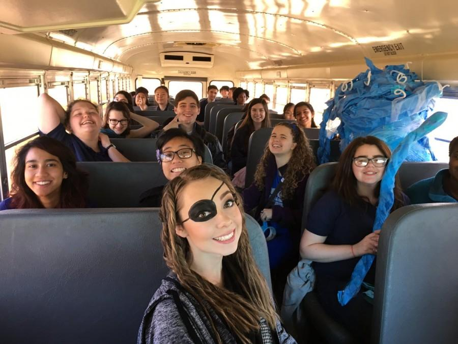 Latin students in various stages of costume dress on the bus to MSU.