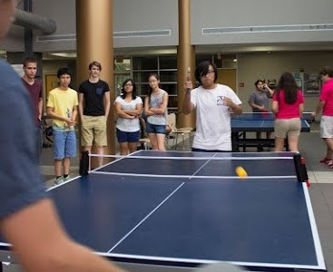 MSMS senior and Co-President of the Ping Pong Club, Meilun Zhou, plays against his opponent at the Ping Pong tournament.