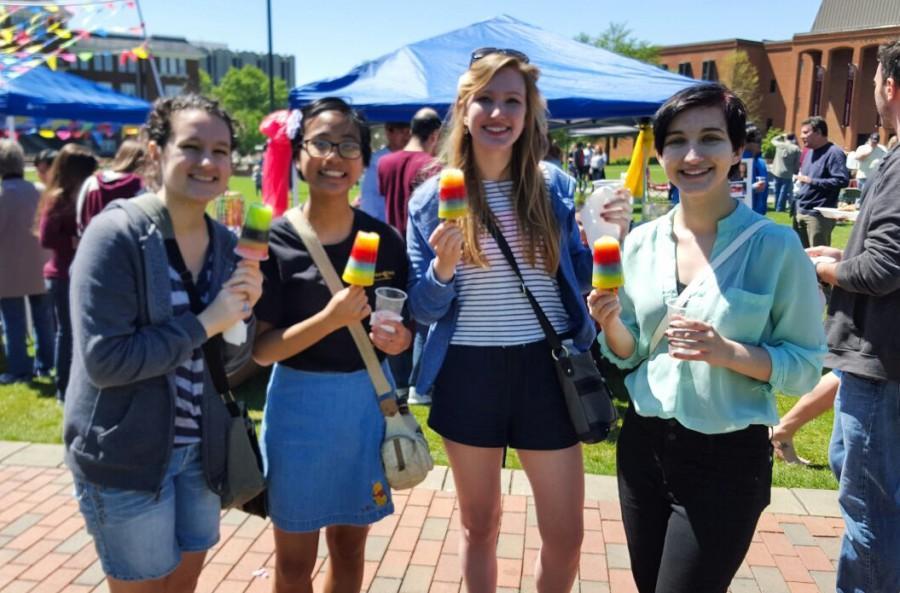 Seniors Ali Otondo, Joy Carino, Abby Perry, and Carly Sneed enjoying Venezuelan rainbow popsicles at the international fiesta.