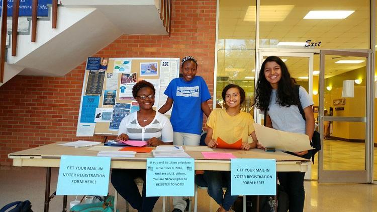 Daudreanna Baker, Jhade Jordan, Ariel Williams, and Wrishija Roy helping students register to vote.