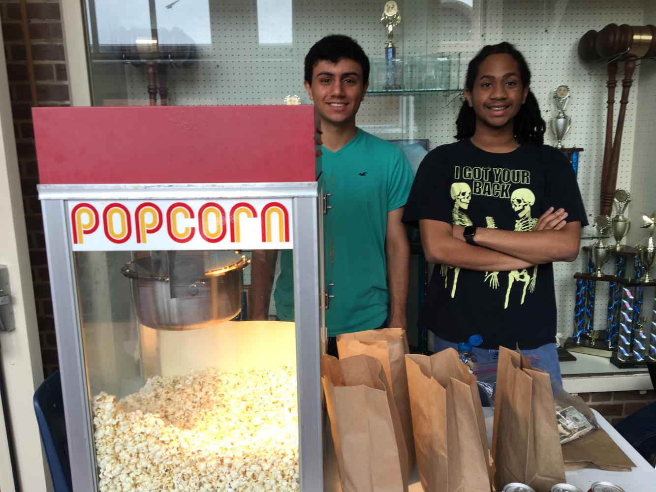 President Yousef Abu-Salah and Reyhan Grimes sell popcorn for the Forgotten Stories club.