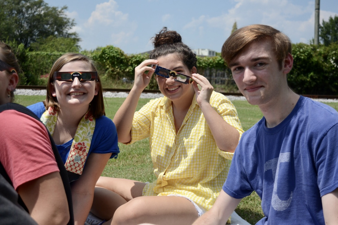 Anna+Katherine+Overstreet%2C+Mackenzie+Umanzor%2C+and+Keegan+Lindsay+sit+on+blanket+while+watching+the+eclipse.+