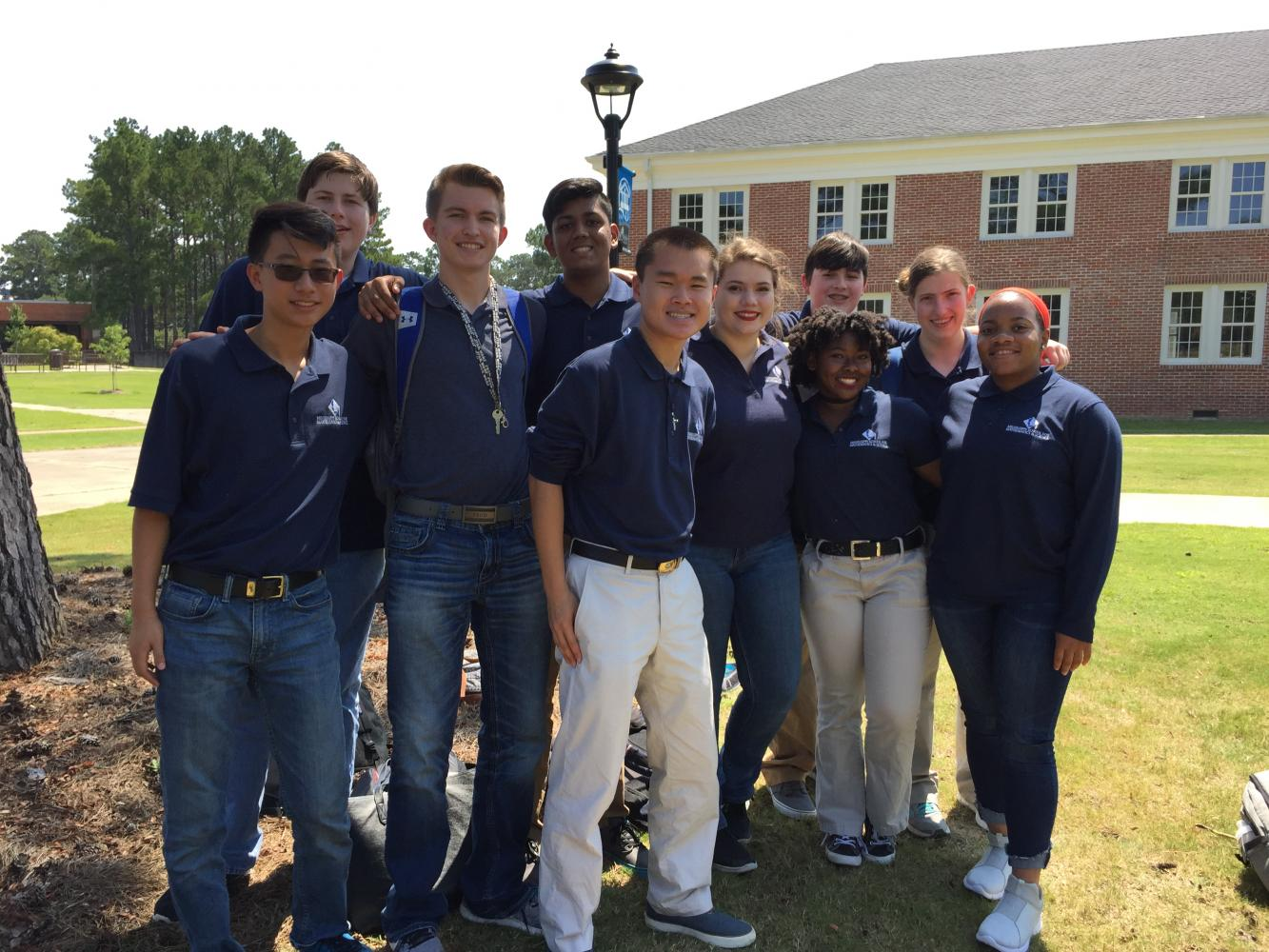 The newly formed robotics team stands outside Cophia-Lincoln Community College, awaiting the reveal of the