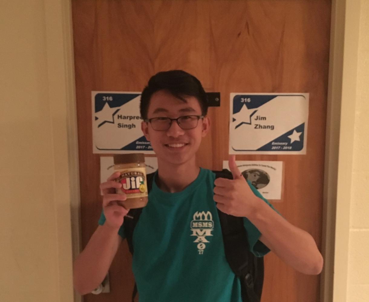 Jim Zhang raises a jar of Jif in celebration of his title as National Merit Semifinalist.