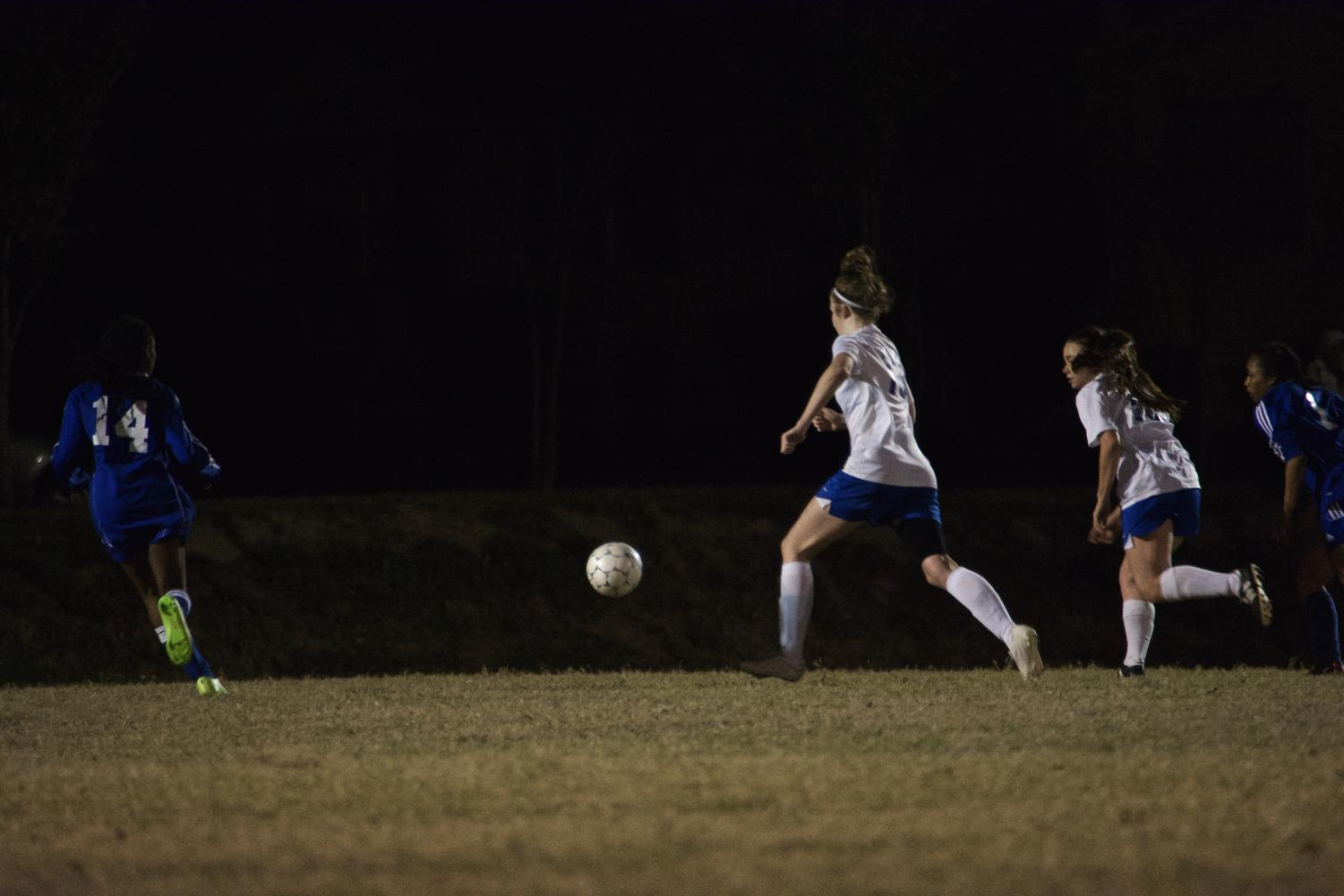 MSMS Lady Waves dribble through the defenses to the goal.