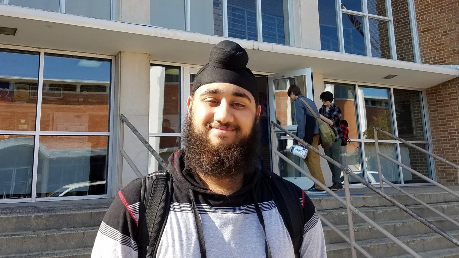 Harpreet Singh puts on a bright smile before heading off to afternoon classes.