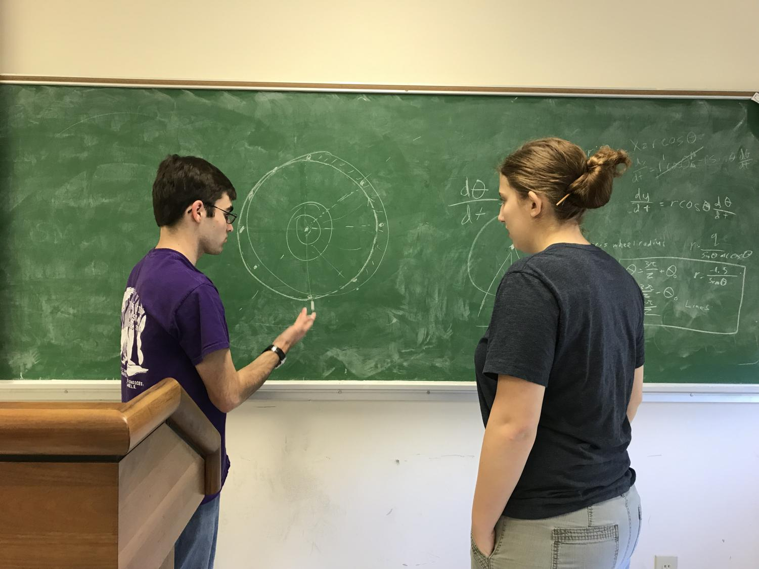 William Johnson and Leah Pettit plan up a storm on the chalkboard.