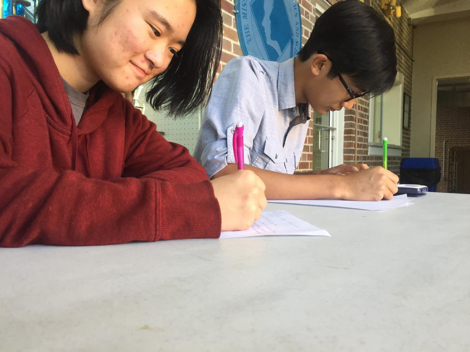 Mu Alpha Theta members Michelle Luo and Gary Nguyen are hard at work at Ala-la-miss