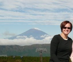 Ms. Heintz poses for a memorable shot in front of Mt. Fuji.