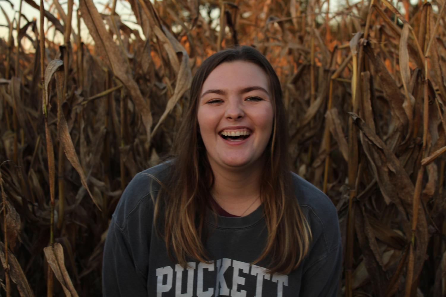 Gabby smiles for the camera in the corn fields.
