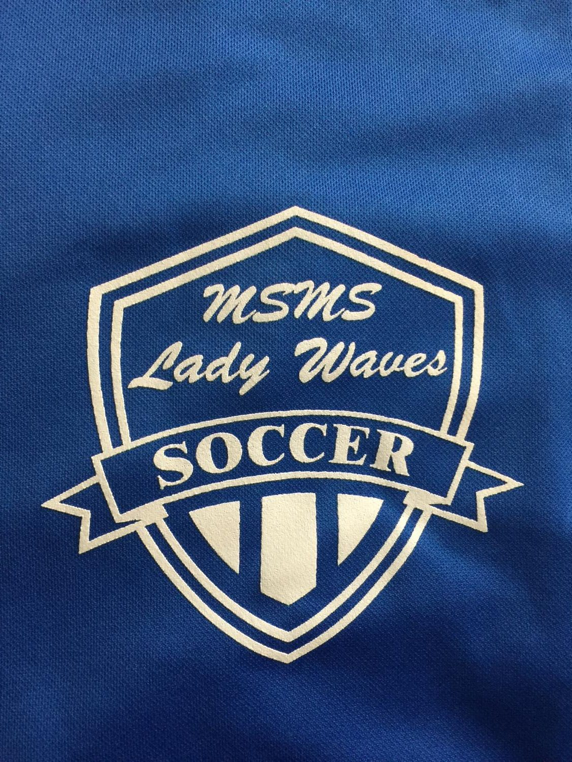 The MSMS Blue and Lady Waves soccer logo shines proudly on their soccer jerseys.