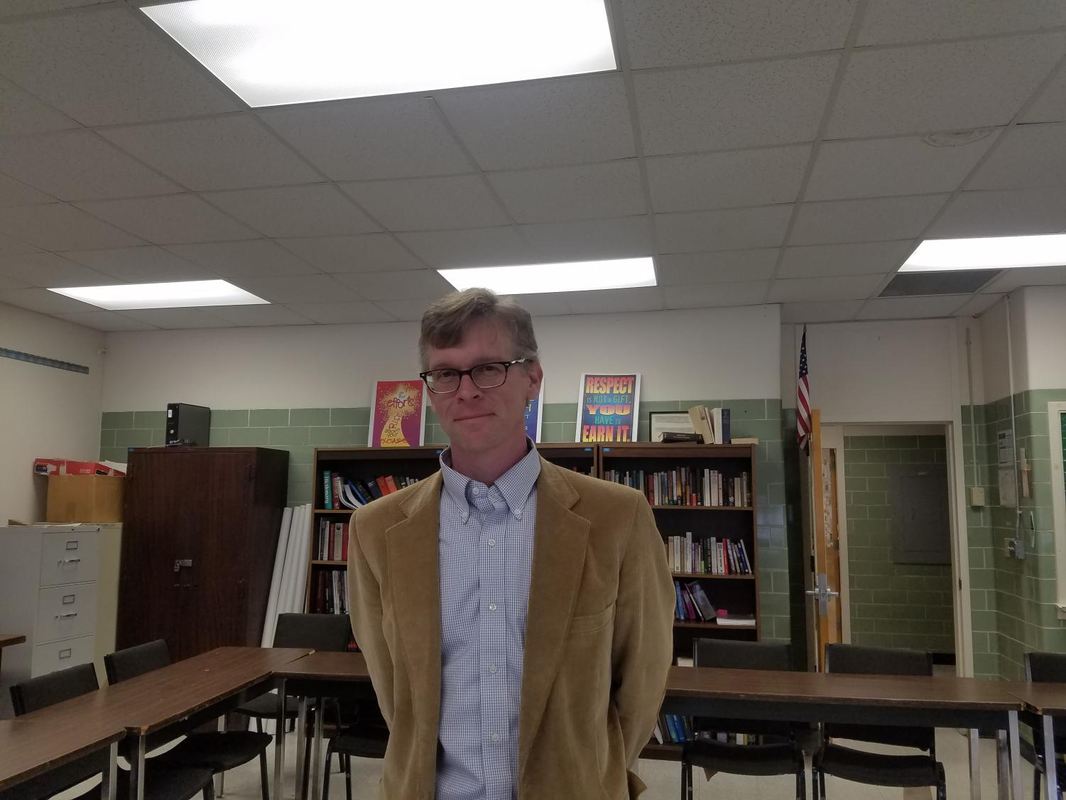 Dr. Easterling stands after class in Hooper 106.