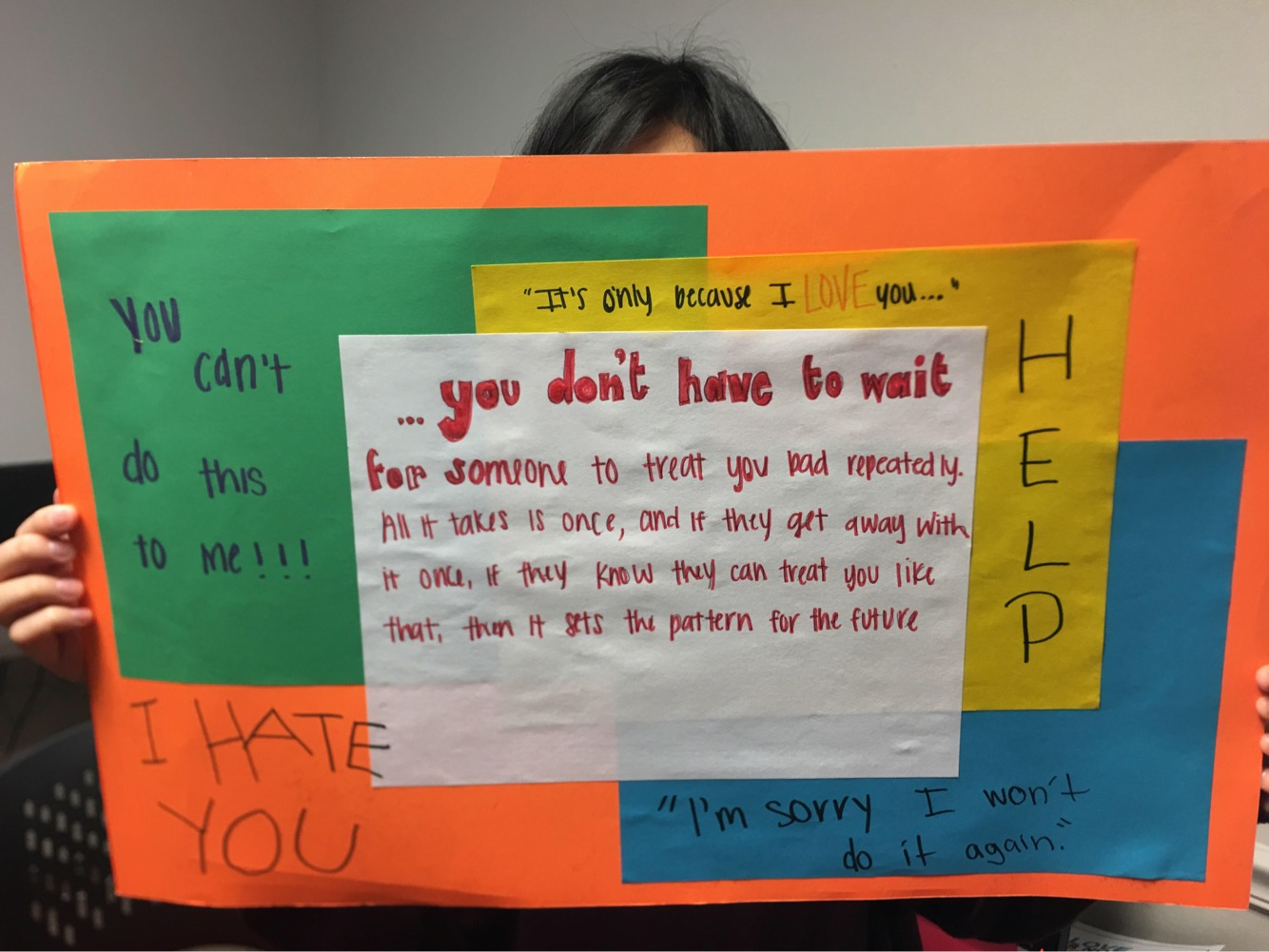 An MSMS student shows the creative poster she made at the seminar.