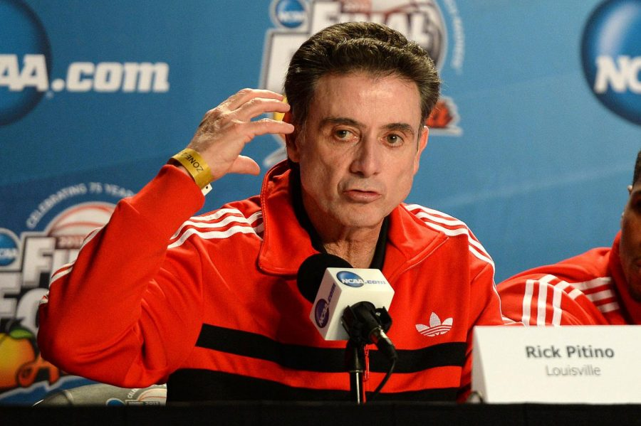 Former+University+of+Louisville+Men%27s+Basketball+head+coach+Rick+Pitino+addressing+the+media+during+the+Final+Four+of+his+2013+NCAA+Championship+season+that+eventually+had+to+be+vacated+due+to+a+recruiting+and+sex+scandal+involving+the+team+and+Pitino.