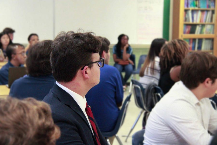 Connor+Chitmon%2C+along+with+the+rest+of+the+Senate%2C+listens+attentively+to+President+Lori+Feng+speak.