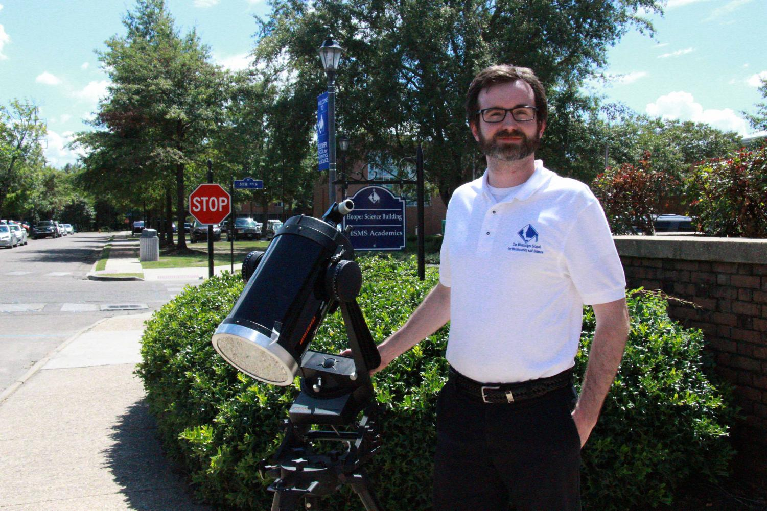 Dr. Vaughan sets up his telescope in front of the Hooper Academic building to view sunspots.