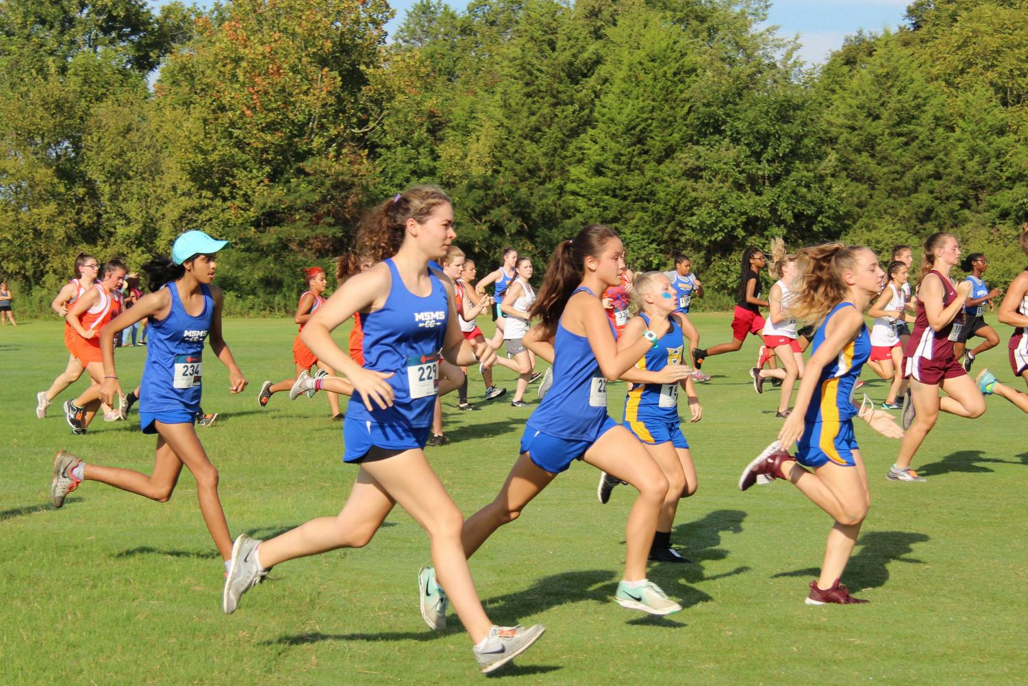 Hailey Desai, Grace-Anne Beech, and Linda Arnoldus begin their 5k race together.