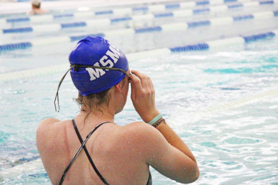 Senior+Breanna+Herd+prepares+to+swim+some+warm-up+laps.