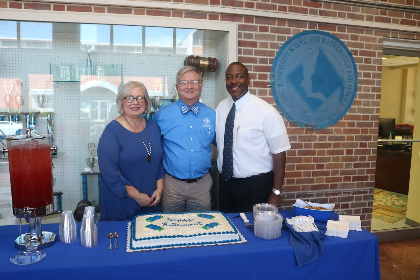 Rick Smith poses with his wife, Judy Smith, and Executive Director, Dr. Germain McConnell.