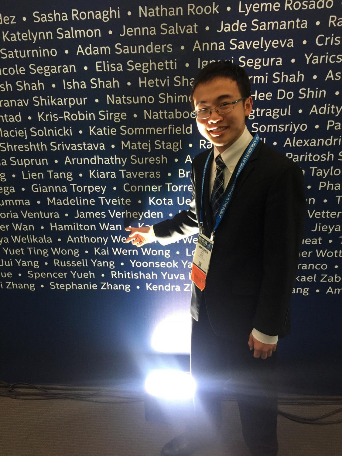 Hamilton Wan points to his name at the International Science and Engineering Fair.