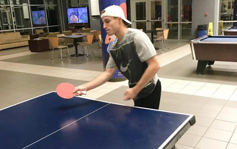 RA Jon Beadlescomb anticipates the approaching ping-pong ball.