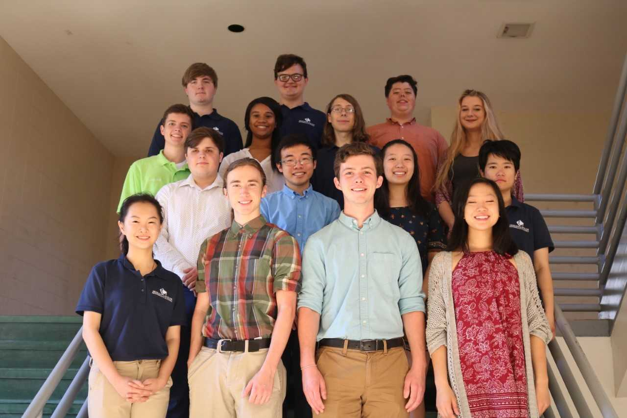 The fifteen National Merit Semifinalists pose for a photo at Trotter Convention Center .
