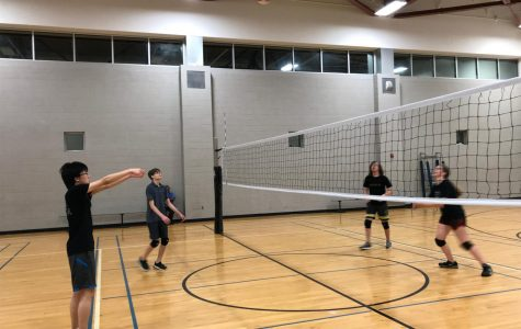 Juniors Nathan Lee, Jackson Hopper, JoJo Kaler and Clara Grady (L to R) are practicing volleyball.