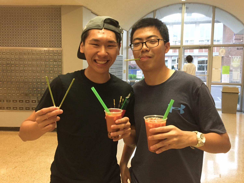 Esmond Tsang and Dennis Lee enjoy boba tea and Pocky.