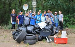 The Student Environmental Awareness League spends their Saturday morning cleaning up at the Luxapalila Creek Park.