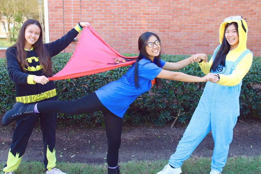 Juniors+Linda+Arnoldus%2C+Gina+Nguyen%2C+and+Catherine+Li+dress+up+as+superheros+for+Breast+Cancer+Awareness+week.