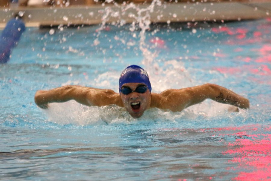 Elijah+Dosda+Competes+in+the+100M+Fly+at+Finals.