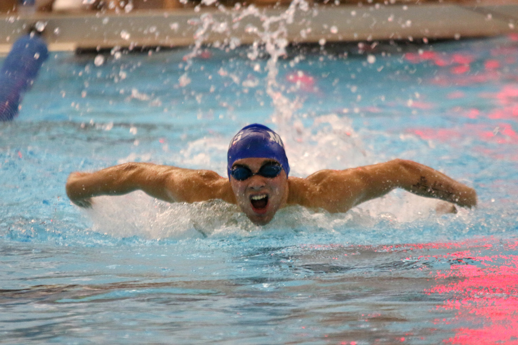 Elijah Dosda Competes in the 100M Fly at Finals.