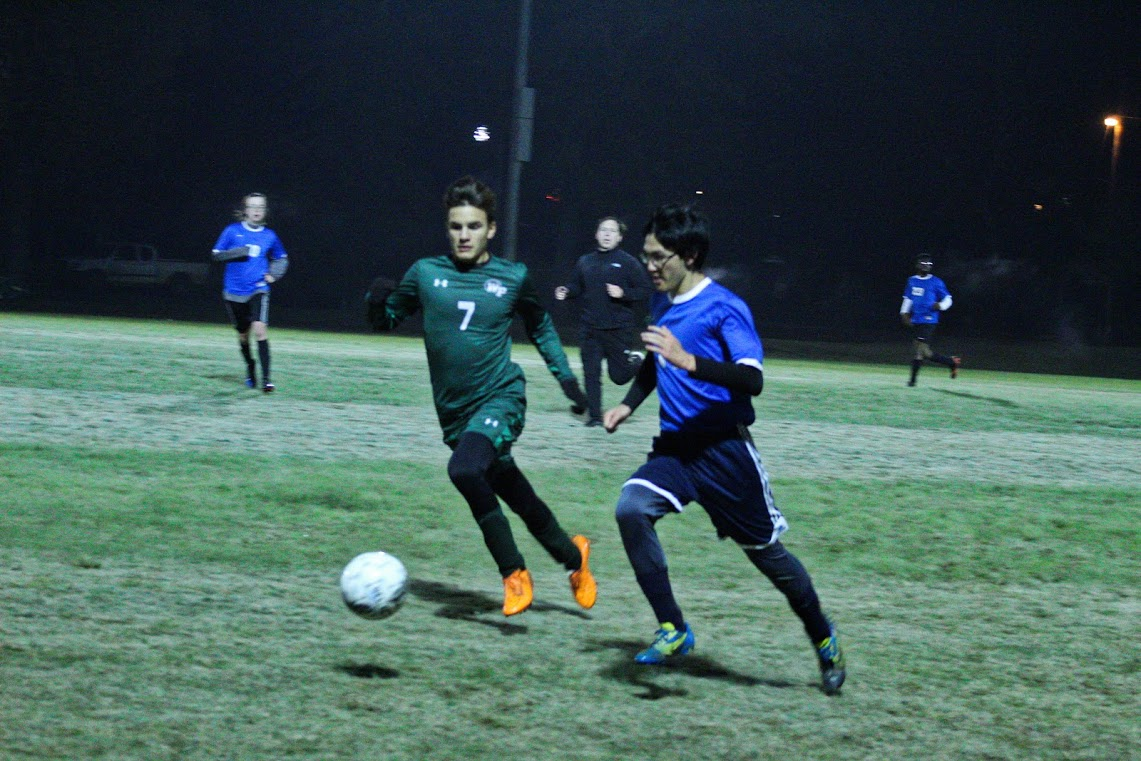 Senior Josh Seid keeps the ball from the opponent.