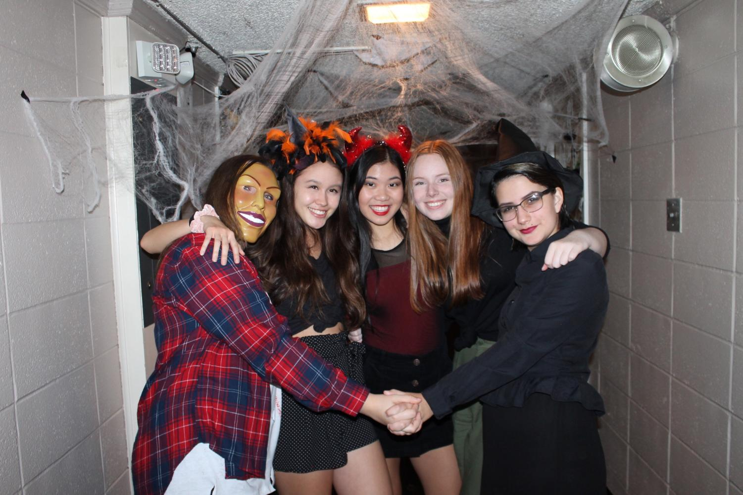 (Left to right) Camryn Mason, Linda Arnoldus, Catherine Li, Alden Wiygul, and Sarah Perry pose in front of their decorated hall.