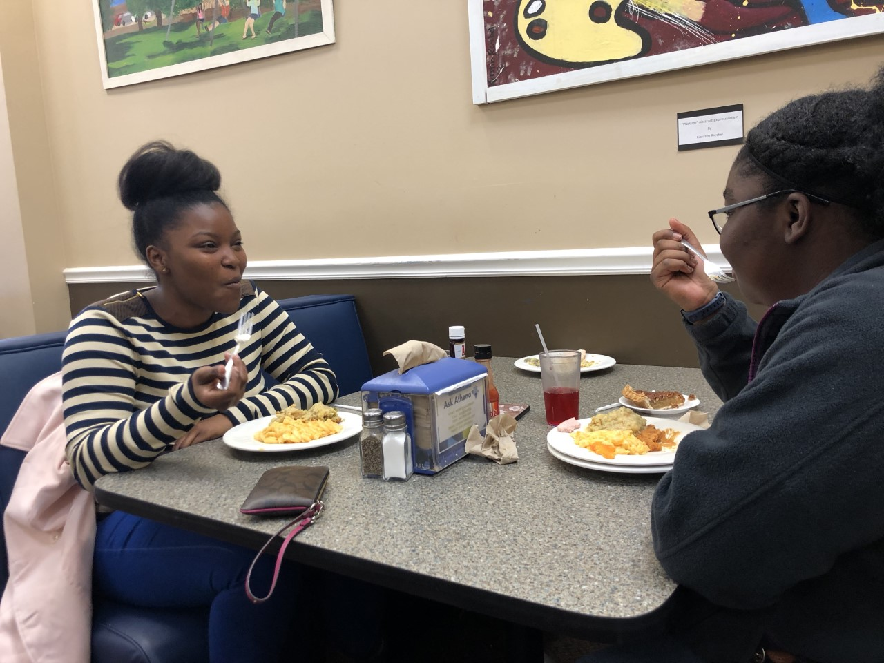Juniors Tiwaniya Tyler and Binta Fadiga enjoy their meal together.