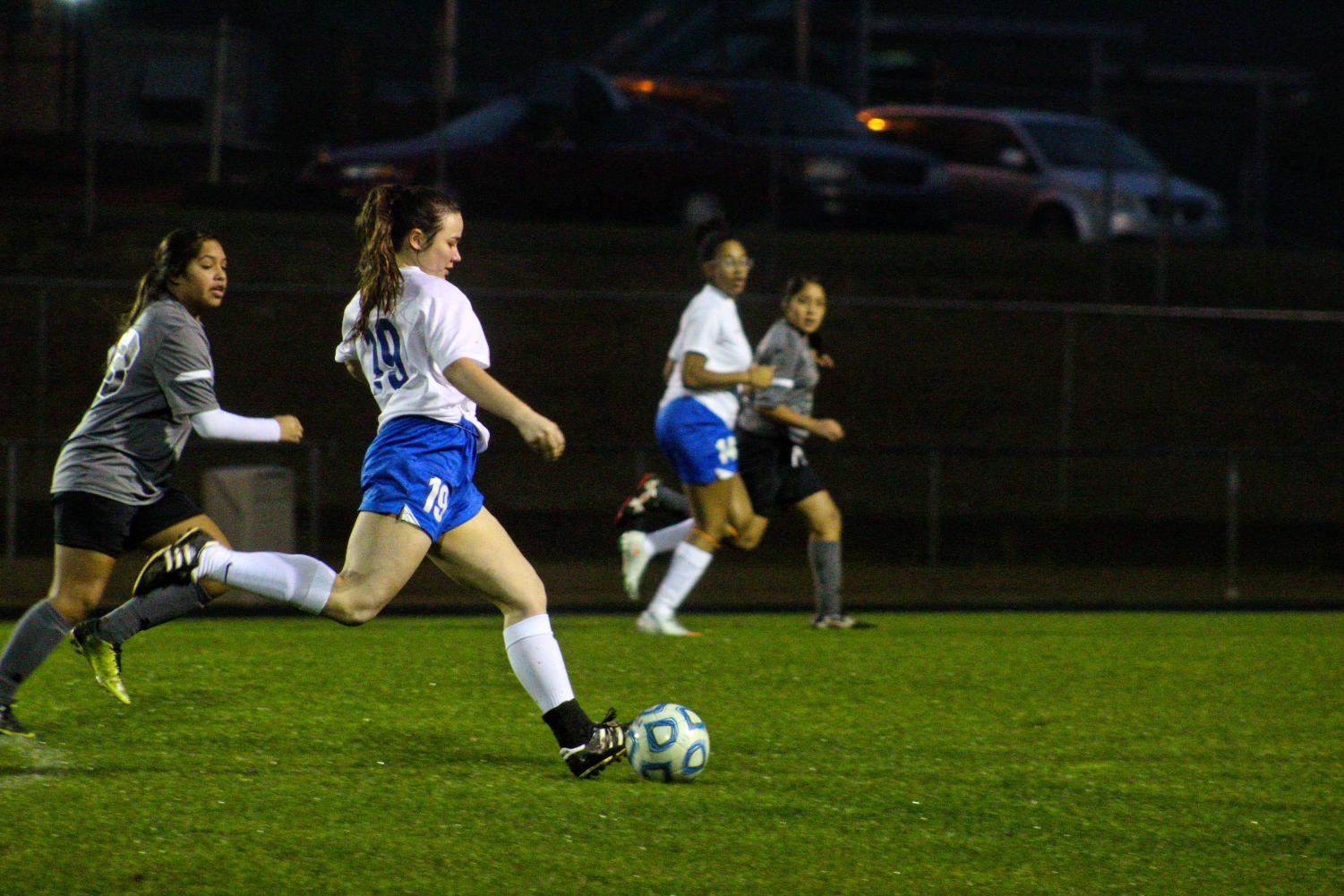 Madison Wypyski dribbles the ball away from the opposing team