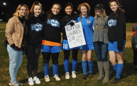 Lady Waves End Season on Soupy Pitch