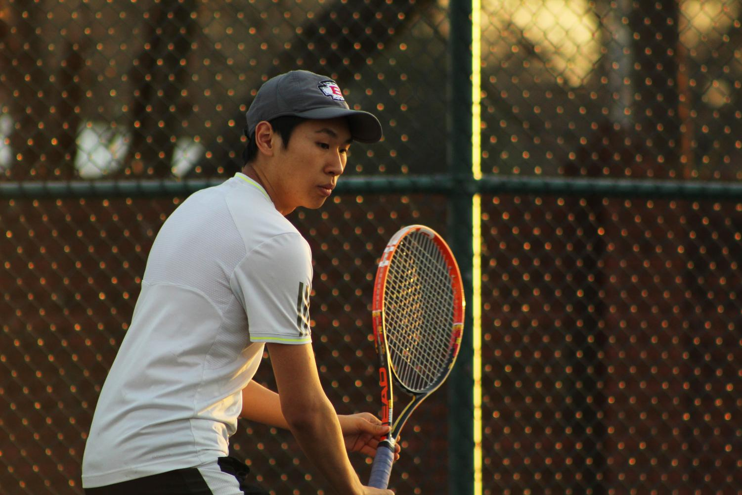 Junior Esmond Tsang concentrates as the ball is hit towards him.