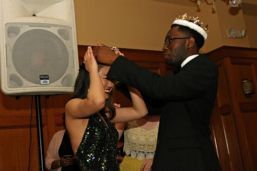 Prom King Morgan Emokpae crowns Lori Feng Prom Queen.