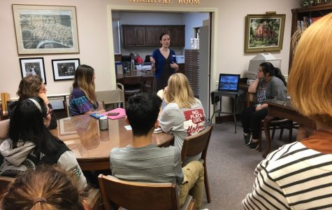 Students sitting in library orientation to prepare for this semesters Tales research.