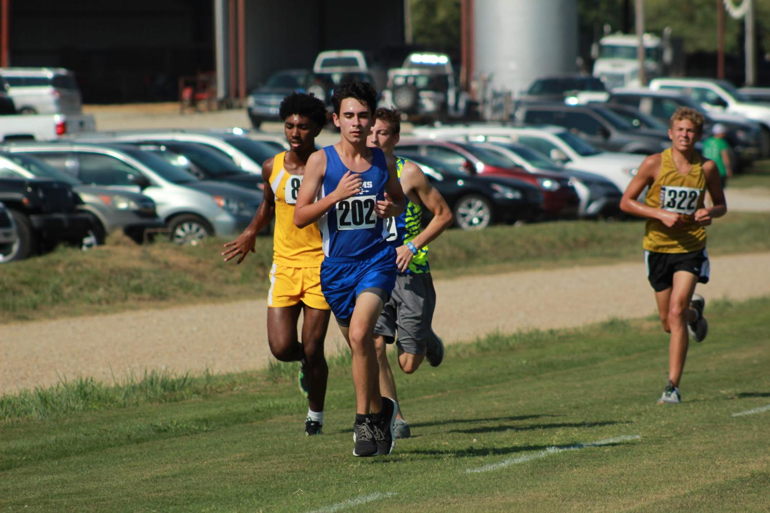 Junior Chandler Bryant keeps his eyes on the finish line and passes up several runners.