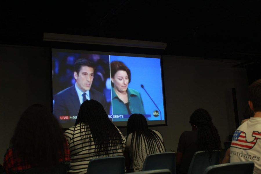 Students+herd+into+Shackleford+Auditorium+to+watch+the+Third+Democratic+Debate.