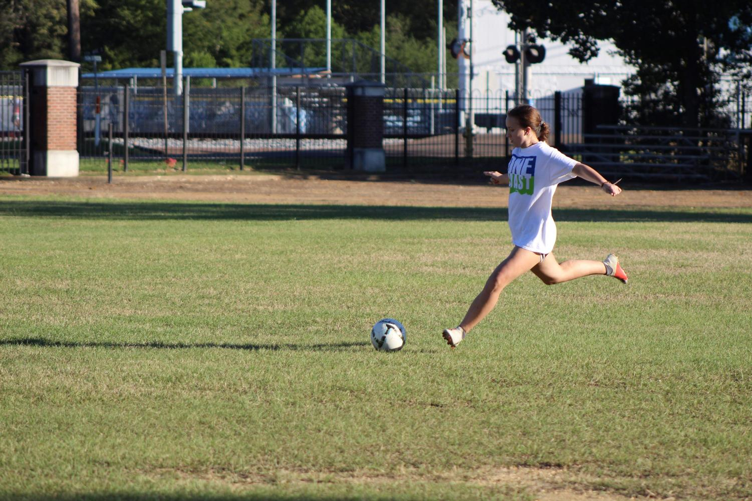 Junior Emily Berry practices kicking during an after school practice.