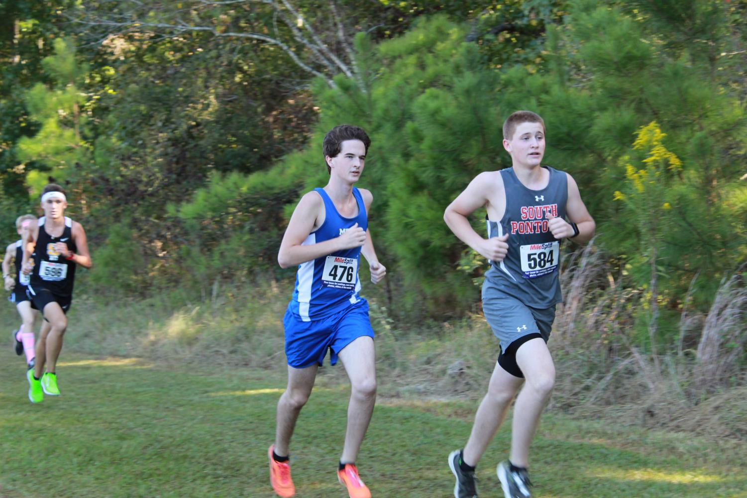Junior Colby Brown emerges from the woods, finishing up his last mile