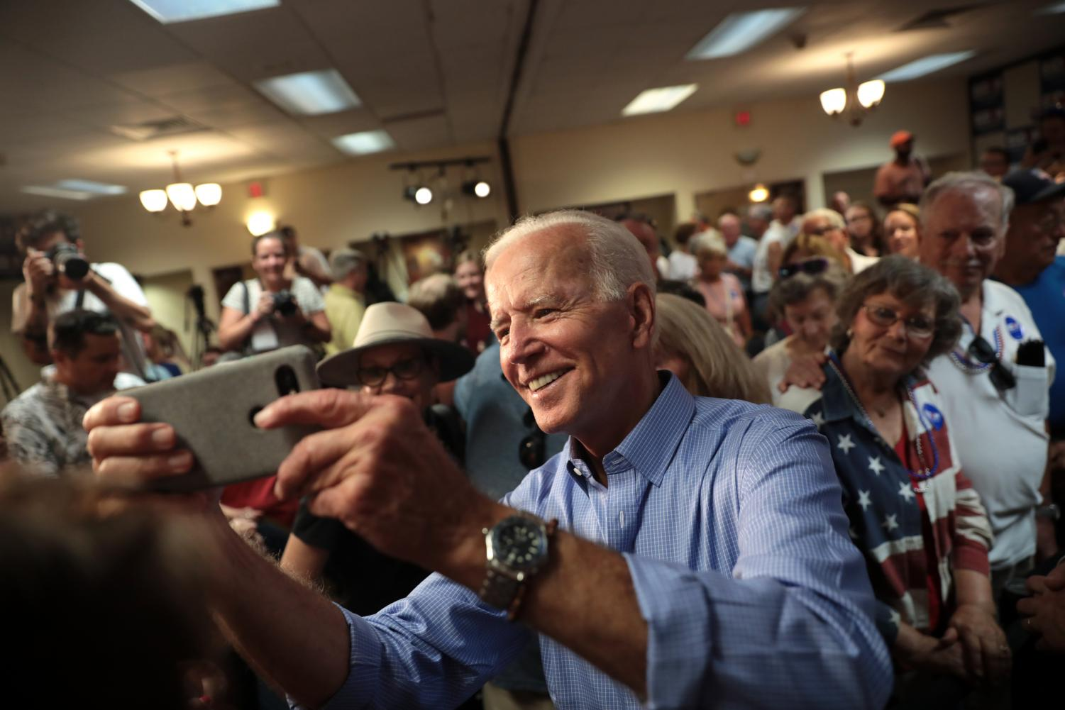 Democratic presidential candidate Joe Biden meets with his supporters at a campaign rally.