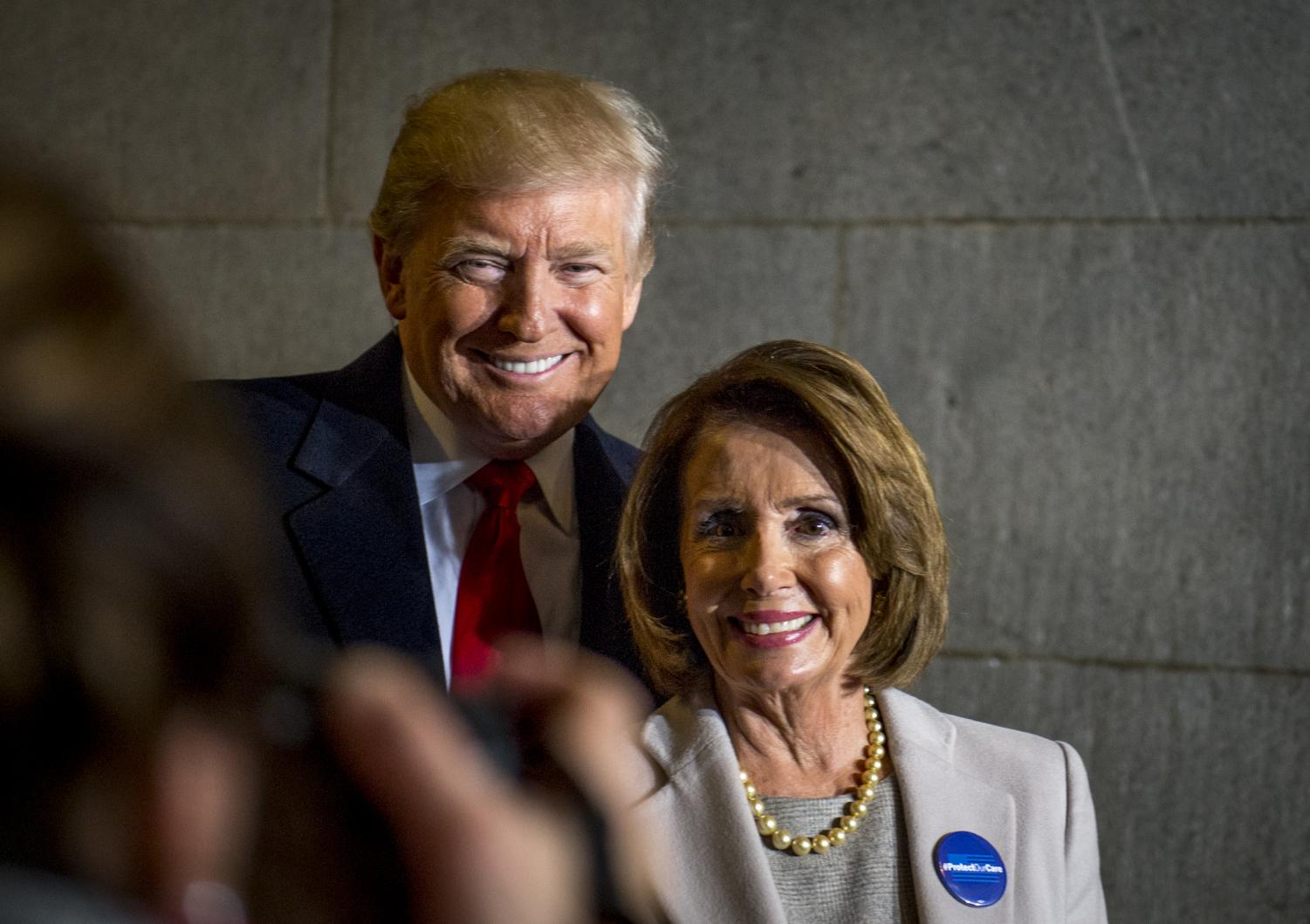 President Donald Trump pictured with Speaker of the House Nancy Pelosi