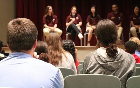 Prospective students look on as several emissaries speak on various topics.