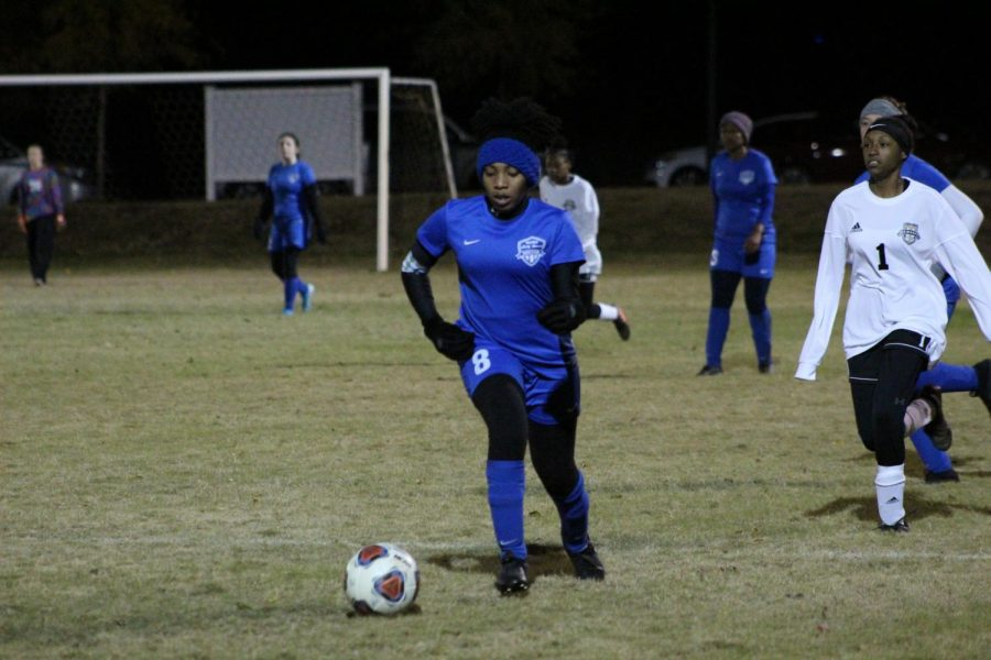 Co-Captain Tierah Macon dribbles the ball downfield towards the Opposing Defense.