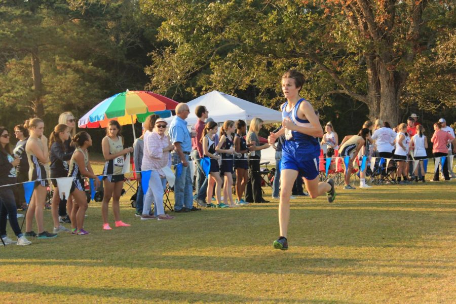 Junior Cameron Wright runs to the finish line on his last mile.