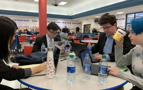 Debate members gather to make final notes before starting the tournament.